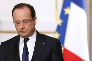 French President Hollande attends a news conference following the weekly cabinet meeting at the Elysee Palace in Paris
